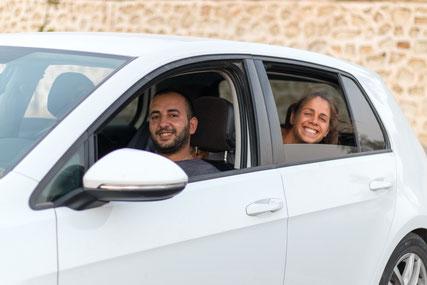 Gökhan and Viviane in his car near Mardin