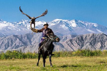 Scenic view of Eagle Hunter Ruslan and his eagle in Bokonbaevo, Kyrgyzstan
