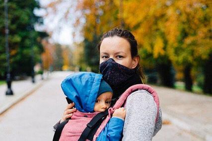 Woman and child wearing mask.