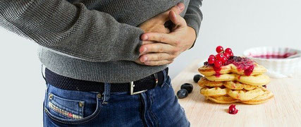 Hungry man holding stomach.
