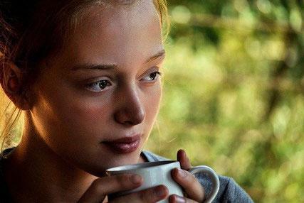 Thoughtful woman drinking tea.