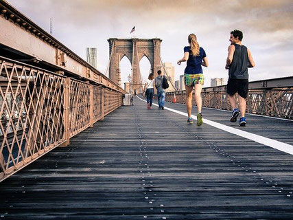 People running by Brooklyn Bridge.