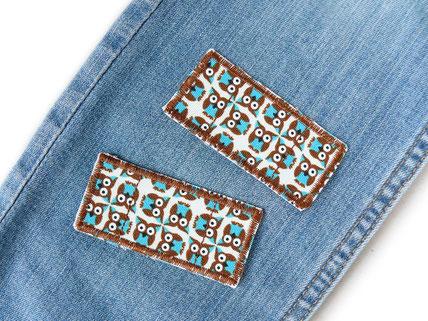 Bild: Mini Bügelflicken für Jeanshose mit kleinen türkis-braunen Eulen