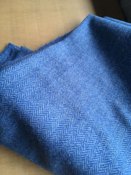 Bright blue Harris Tweed bearing a herringbone pattern