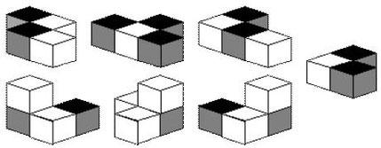 I sette pezzi del Cubo Soma a quadretti bianchi e neri