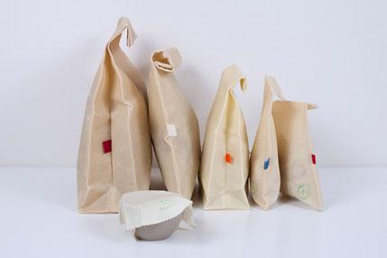 Bienenwach Snacksack. Drei Tüten als Link zur Shopseite zu den Produkten aus bienengewachsten Naturstoffen.