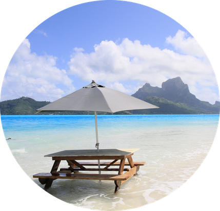 Parasol on the beach on Motu (islet) in Bora Bora