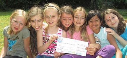 """Juin 2014- 2ème chèque de 570 euros pour""""Enfants de l'univers"""""""