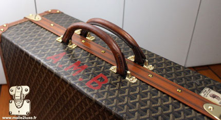poignée parfaite pour valise de luxe Goyard
