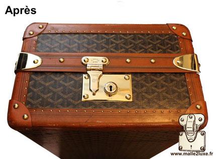parfait polissage des laitons sur une valise Goyard ancienne