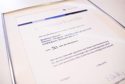 Ehrenurkunde der Handwerkskammer Region Stuttgart für das 50-jährige Bestehen der Firma Raisch Fliesen.