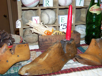 Shoe Forms, old baseballs, land o lakes, vintage squirt bottle.