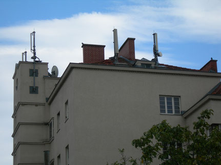 Various cell phone antennas on apartment building