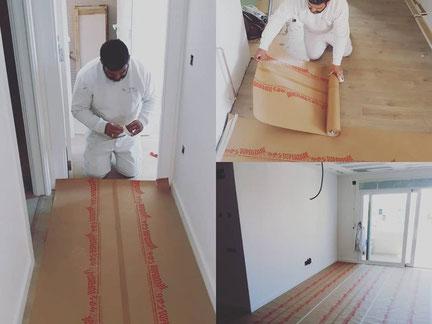 empapelando el suelo  con papel para pintar paredes