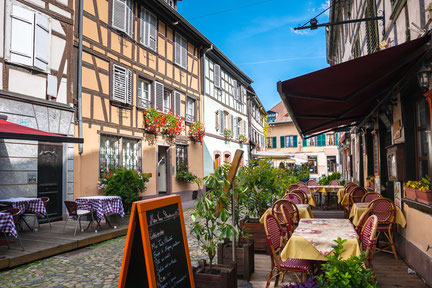 Cafes in Petite-France in Strasbourg. Petite-France is an historic area in the center of Strasbourg, France Copyright Sergey Kelin