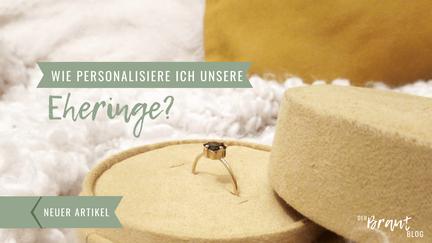 """Eine Ehering steckt in einem Ringkissen. Aufschrift """"""""Wie personalisiere ich unsere Eheringe""""."""