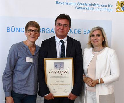 Foto: StMGP, mit Heiner Röschert und Gesundheitsministerin Melanie Huml