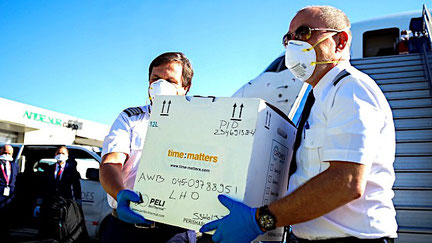 Pilots acting as couriers, pictured while handing over life-saving stem cells