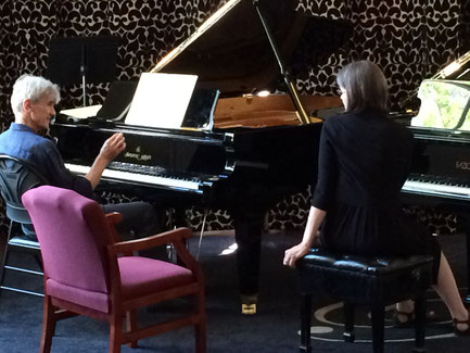 Joann taking a lesson from pianist Paul Roberts.