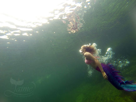Jamie Jaime the Mermaid swimming at Blue Pool, New South Wales, Australia.