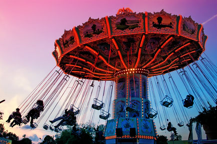 Merry-go-round spinning with people against the sunset sky Copyright pryzmat