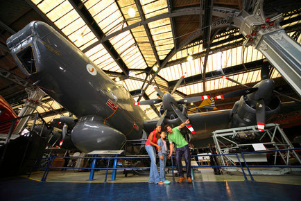 Family looking at aircraft inside the Air & Space Hall at the Museum of Science and Industry in Manchester, Manchester