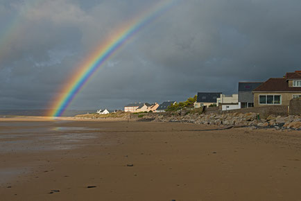 Regenbogen am Strand von Siouville.