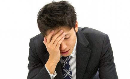 腰痛で悩む奈良県御所市の男性