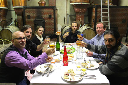 Ryan Maloney, Brian Cisc, Christine Cooney, Jean-Roger Groult, Bret Pontoni, and Nima Ansari enjoy a break in their still side meal, hosted by Calvados Roger Groult.