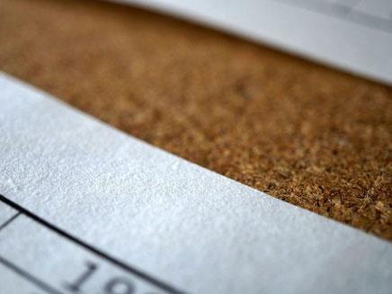 社史は大判和紙のラフな素材感の裏面にプリントしました