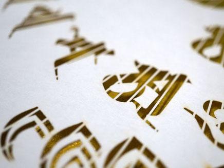 お寺にある石碑の梵字をレーザーカット加工した和紙製品