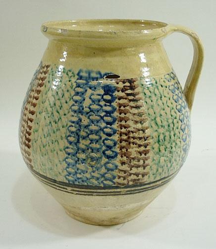Folk art slipware jug