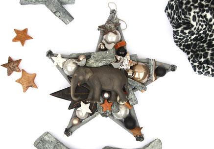 Stern in den Farbtönen grau und Braun mit Elefant - einem schwarzem Holzblatt - grauer Rinde und Glaskugeln.
