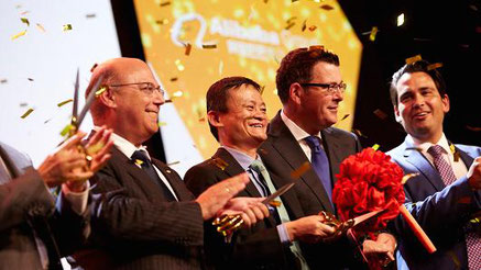 Alibaba's Jack Ma and Australian Post officials celebrate the opening of the new head office.