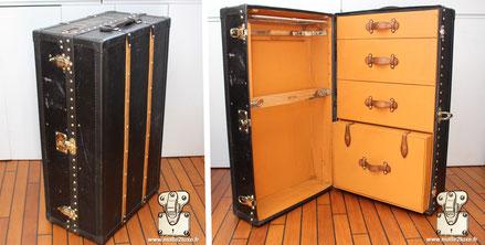 Malle wardrobe Louis Vuitton - Vuittonite Extérieur : Toile vuittonite jaune Bordure : lozine noir Coins : acier Intérieur : Double penderie 91 cm x 56 cm x 35 cm