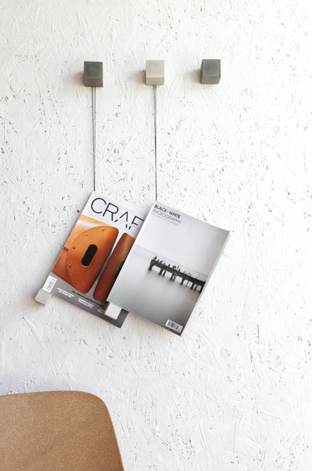 A modern concrete and backer twine magazine wall display diy