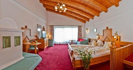 Doppelzimmer mit Kachelofen