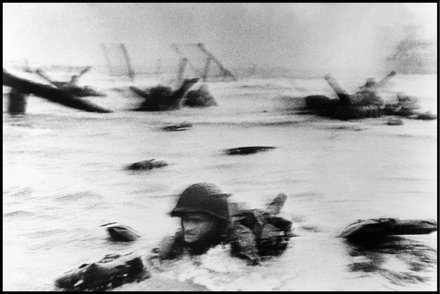 FRANCE. 1944. Normandy. Omaha Beach. The first wave of American troops lands at dawn. Robert Capa. www.magnumphotos.com