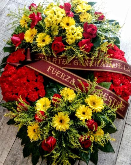 Corona de flores con la bandera de España