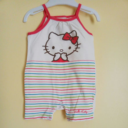 Vetements d'occasion pour bébé fille. Barboteuse Hello Kitty 6 mois