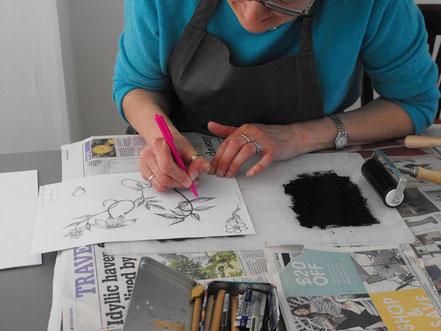 Designing an image at a drypoint etching printmaking workshop