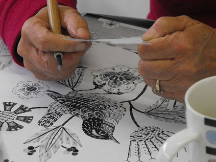 Preparing an image at a printmaking workshop