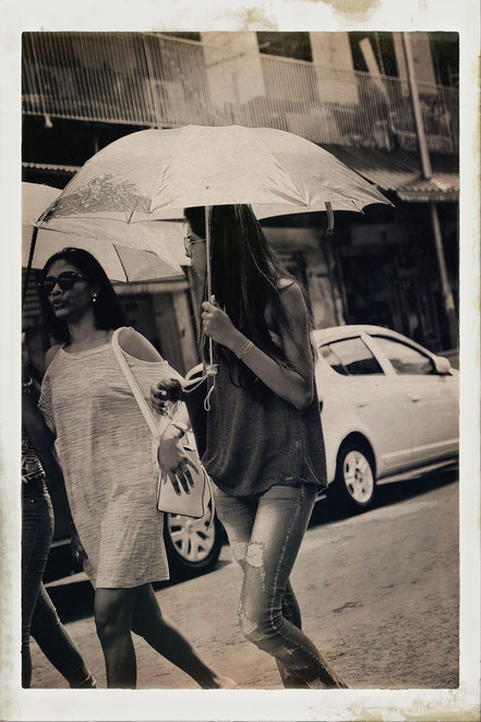 Mauritius woman with umbrella