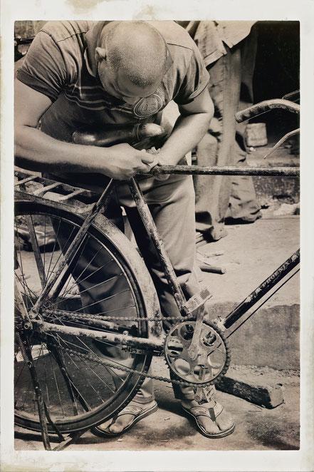 Mauritius man fixing bike