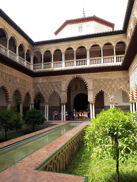 "Main Patio in the foreground and ""ambassadors reception hall"" in the background in the Real Álcazar"