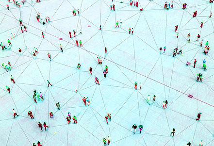 Menschen bilden Netzwerk. Systemischer Blick beim Coaching.