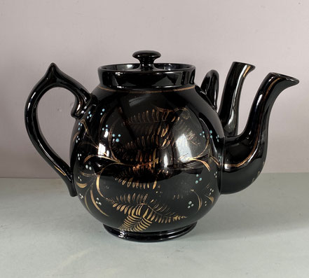 Large teapot with two spouts, dated 1905, possibly Jackfield Pottery
