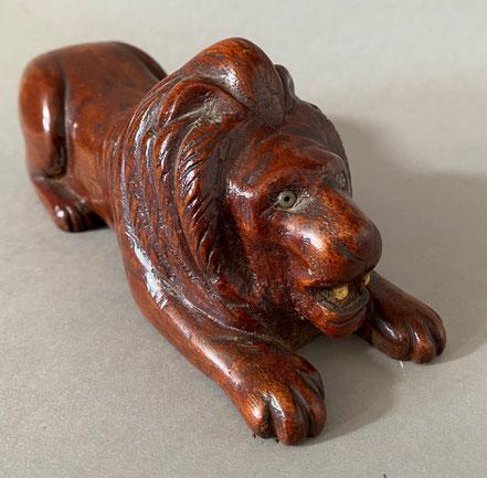 A folk art treen model of a recumbent lion.  Late 19th century.