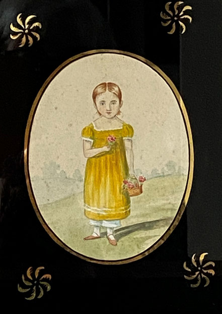 Naive miniature of a girl in a yellow dress