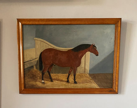 Naive oil on panel portrait of a horse in his stable.